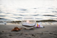 One candle at the sea. Spa theme Royalty Free Stock Photography