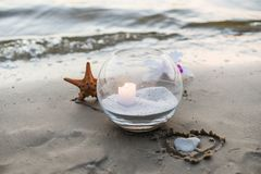 One candle at the sea. Spa theme Stock Photos