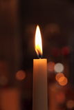 One candles in church as background Stock Photo