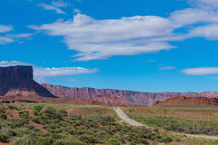 One car on a deserted highway in southern Utah. One car on a paved highway in canyon and mesa country of Southern Utah Stock Images