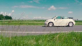 One car is moving from right to left in slow motion stock footage