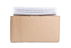 One Cardboard Box and Stack of Calendars Royalty Free Stock Image
