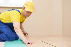 Cork worker at flooring work Stock Photo