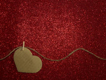 One carton heart attached to the rope on shining background Royalty Free Stock Photography