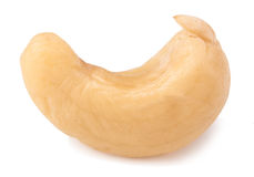 One cashew  on white background close-up macro Royalty Free Stock Image