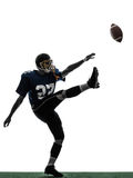 American football player man kicker kicking silhouette. One caucasian american football player man kicker kicking in silhouette studio  on white background Stock Images