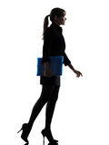 Business woman  holding folders files walking silhouette Royalty Free Stock Images
