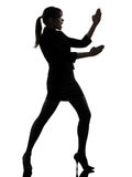 Business woman karate self defense silhouette. One caucasian business woman karate self defense  in silhouette studio  on white background Royalty Free Stock Photo