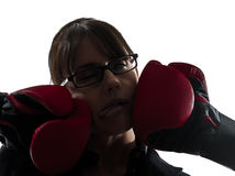 Business woman punched  by boxing gloves silhouette Stock Photo