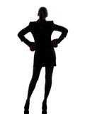 Business woman ready fighting boxing gloves silhouette Stock Photos