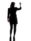 Business woman writing  holding folders files silhouette Royalty Free Stock Image