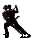 Couple man woman ballroom dancers tangoing  silhouette. One caucasian couple men women ballroom dancers tangoing  in silhouette studio  on white background Royalty Free Stock Photography