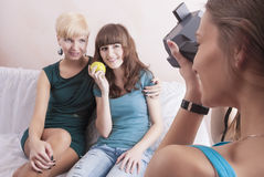 One Caucasian Girl Photographs Her Girlfriends Sitting Together Stock Photo