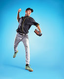 The one caucasian man as baseball player playing against blue sky. Collage Royalty Free Stock Photography