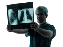 Doctor surgeon radiologist examaning lung torso  x-ray image Stock Photography