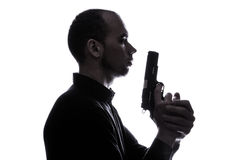 One caucasian  man holding gun portrait silhouette Royalty Free Stock Photo