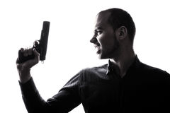 One caucasian  man holding gun portrait silhouette Stock Photography