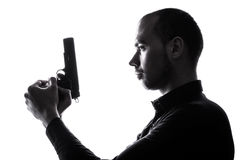 One caucasian  man holding gun portrait silhouette Stock Photos