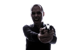 One caucasian  man holding gun portrait silhouette Royalty Free Stock Photo