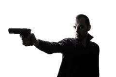 One caucasian  man holding gun portrait silhouette Stock Photos