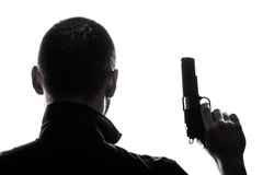 One caucasian  man holding gun portrait silhouette Royalty Free Stock Image