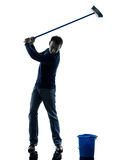 Man janitor brooming cleaner golfing silhouette full length Stock Photos