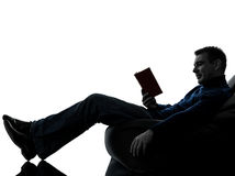Man reading book silhouette full length Stock Image