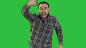One caucasian man running and calling for someone, trying to get someones attantion on a Green Screen, Chroma Key.