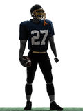 Quarterback american football player man standing silhouette. One caucasian quarterback american football player man standing in silhouette studio  on white Royalty Free Stock Images