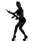 Sexy woman in army uniform holding kalachnikov silhouette Stock Photography