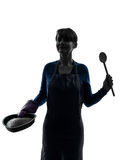 Woman cooking cake pastry silhouette Royalty Free Stock Image