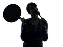 Woman cooking holding frying pan thinking silhouette Royalty Free Stock Photos