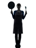 Woman smiling cooking holding pan silhouette Stock Photography