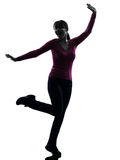 Woman happy stretching  silhouette Royalty Free Stock Photo