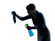 Woman maid housework sprayer silhouette Stock Photos
