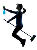 Woman maid housework flying broom silhouette Stock Photo