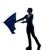 Woman opening closing  umbrella silhouette Royalty Free Stock Image