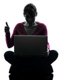 Woman thumb up computing laptop computer silhouette Stock Photography