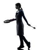Woman walking cooking cake pastry silhouette Stock Image