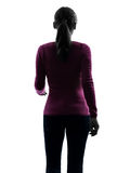 Woman walking portrait rear view silhouette Royalty Free Stock Photo