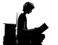 One caucasian young teenager silhouette boy or girl reading Royalty Free Stock Image