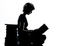 One caucasian young teenager silhouette girl reading Royalty Free Stock Image