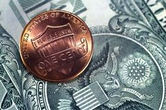 One cent on the background of the coat of arms USA. Royalty Free Stock Photos