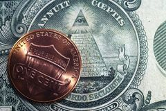 One cent on the background of the Masonic sign. Can be used as background on the subject of finance, numismatics, abstraction, etc royalty free stock photo