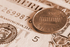 One cent coin on banknote close up Royalty Free Stock Photography