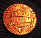 One cent coin. During the night in low light Stock Photo