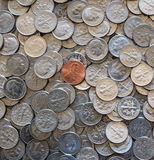 One cent coin on pile of 10 cent coins. American one cent coin on pile of 10 cent coins Royalty Free Stock Photos