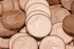 One cent coins. Disordered currencies of euro cent Stock Photo