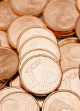 One cent coins. Disordered currencies of euro cent stock images