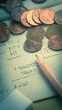 One cent coins and pencil place on scrap paper Royalty Free Stock Photo